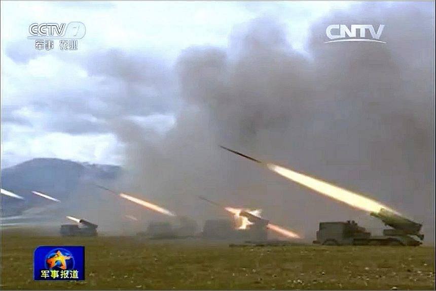 A screenshot from a report on Chinese state television's military channel about the 31st Group Army, based in the Chinese city of Xiamen, carrying out drills. The Wednesday report said the exercises were carried out in recent days, without giving an