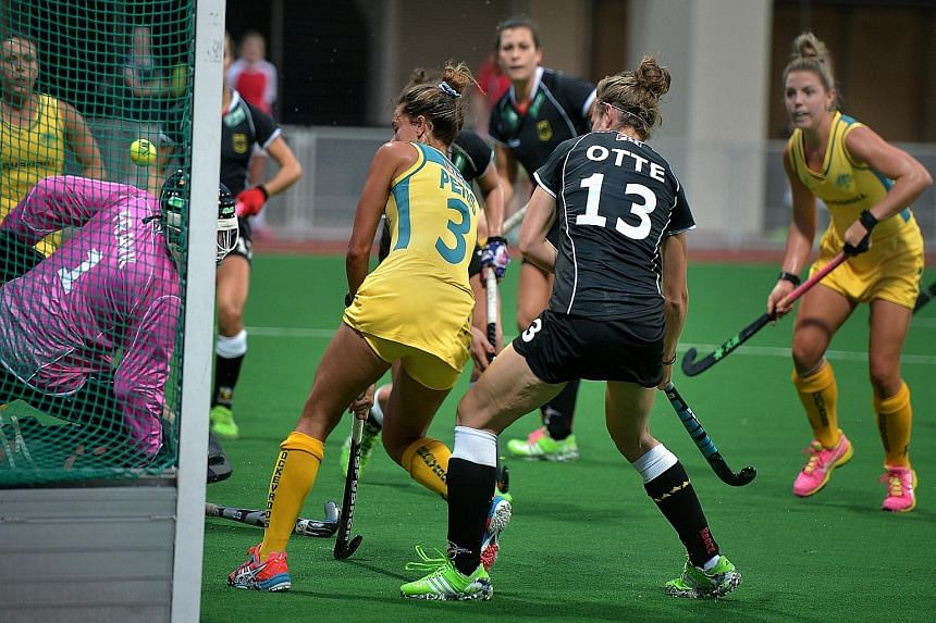 Australia's Brooke Peris (No. 3) slipping in the opening goal against Germany. The Hockeyroos won the game with a 3-1 scoreline.