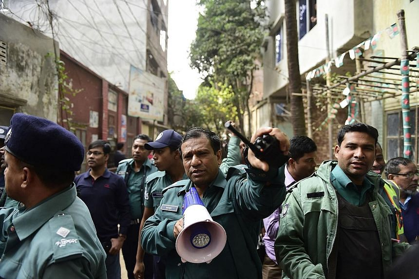 Bangladeshi police officials securing the area after a raid on a building housing suspected militants in Dhaka last month.