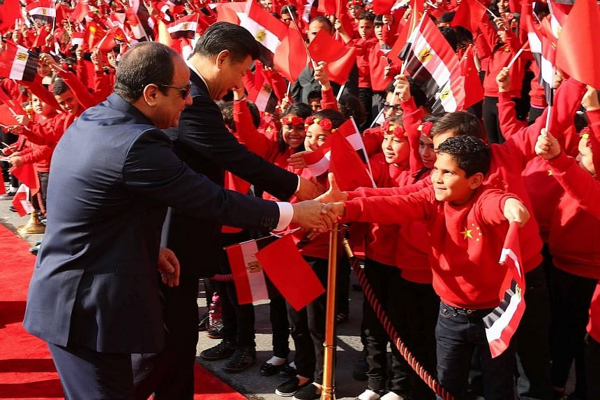 Children greeting Egyptian President Abdel Fattah al-Sisi and Chinese President Xi Jinping during a welcome ceremony in Cairo.