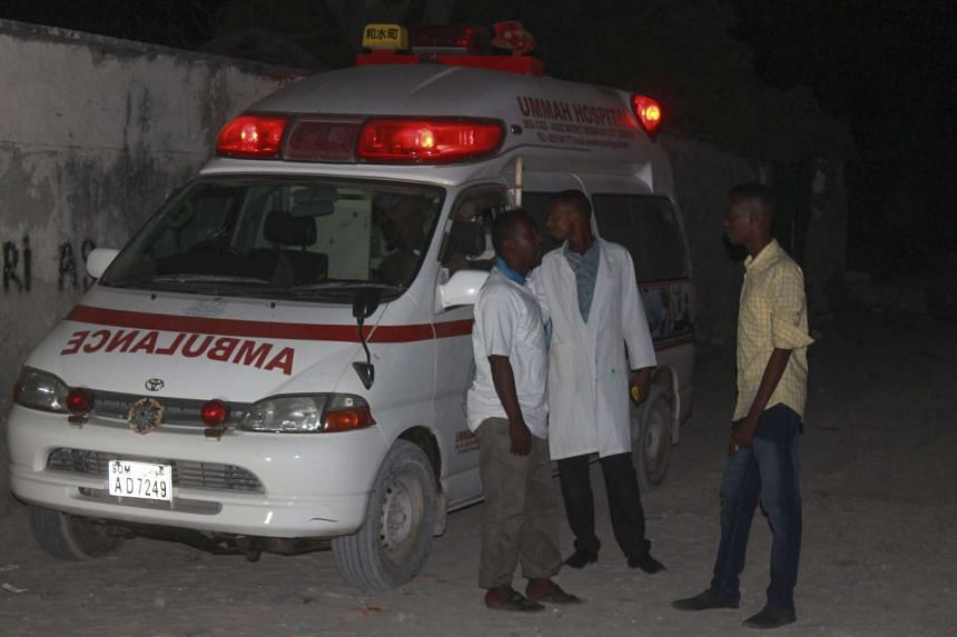 Ambulance workers near the Lido beach where gunmen exploded a car bomb and opened fire at a restaurant in Mogadishu on Jan 21.