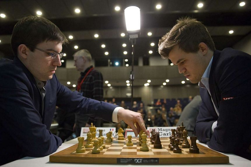 Chess players Maxime Vachier-Lagrave (left) and Magnus Carlsen in action in a 2014 file photo.