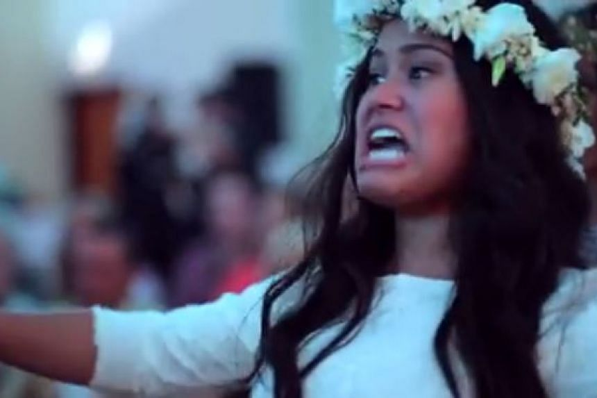 Bride Aaliyah Armstrong joins her friends and family who performed a Maori haka at her New Zealand wedding.