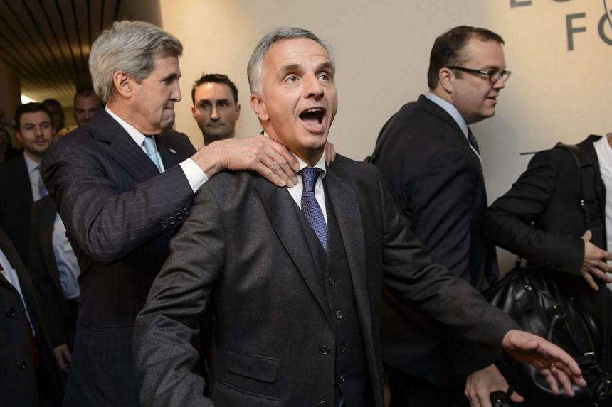 Kerry (left) and Swiss Minister of Foreign Affairs Didier Burkhalter (centre) share a light moment in Davos.