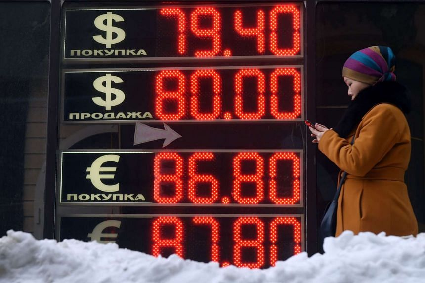 A board lists foreign currency rates against the Russian rouble in Moscow, on Jan 20, 2016.