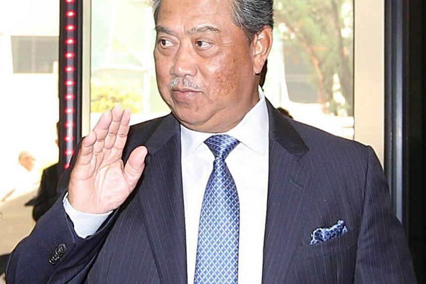 """In a show of support, former deputy PM Muhyiddin (above) said Mr Mukhriz is a corruption-free individual who is """"not tangled in accusations of moral wrongdoings, breach of trust and bribery""""."""