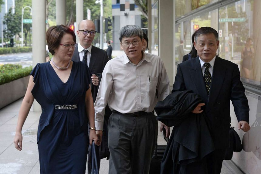 Ms Sylvia Lim (far left), Mr Png Eng Huat (centre) and their lawyer Peter Low (far right) arriving at the Supreme Court on Jan 22, 2016.
