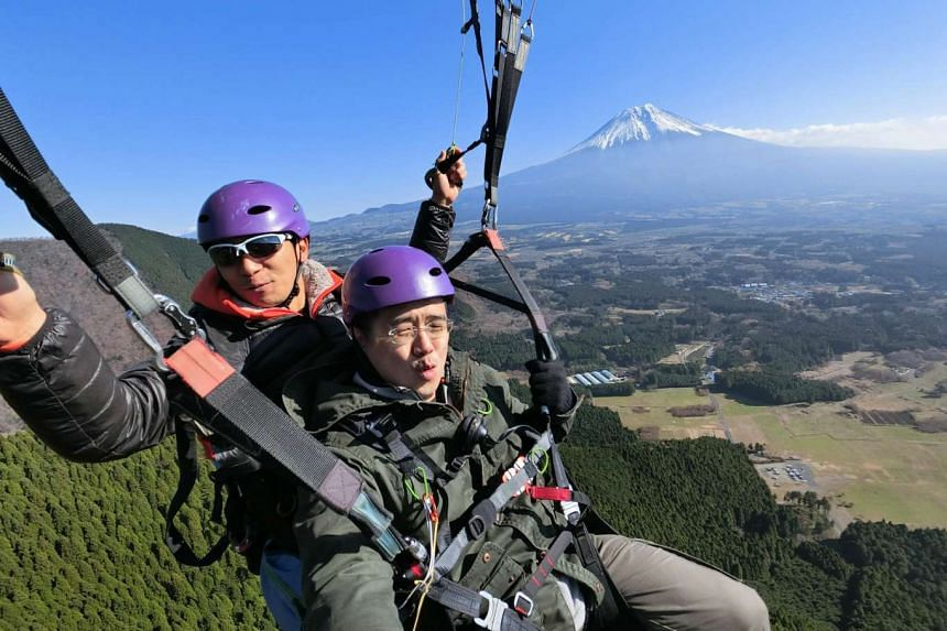 Deputy Tech Editor Trevor Tan using the Casio Exilim EX-FR100 mounted on Casio EAM-4 selfie stick to take this picture of him and his paraglider near Mount Fuji at around 1,000m above sea level.