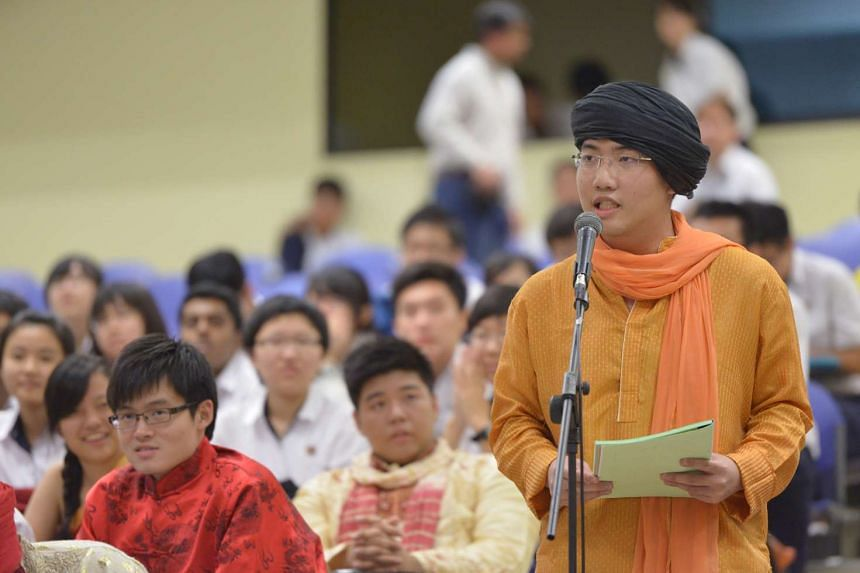 An ACJC student, dressed for the school's Racial Harmony Day celebrations, asking a question at a dialogue on the media's role in covering religion held at the school in 2012.