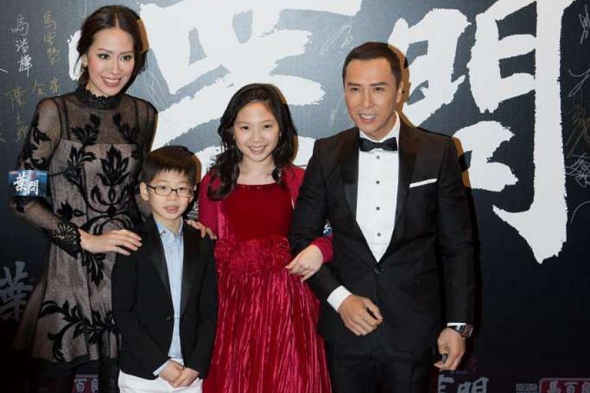 Hong Kong action star Donnie Yen (right) and his wife, Cecilia Wang (extreme left) and their children at Resorts World Sentosa on Jan 15, 2016.