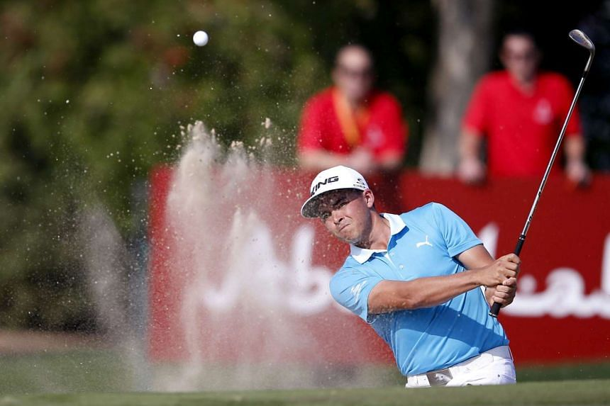 US golfer Rickie Fowler hitting a shot from a bunker during the Abu Dhabi HSBC Golf Championship on Jan 22.