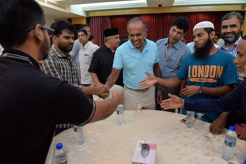 Mr K Shanmugam (centre) mingling with some Bangladeshi workers at the Khadijah Mosque on Jan 23, 2016.
