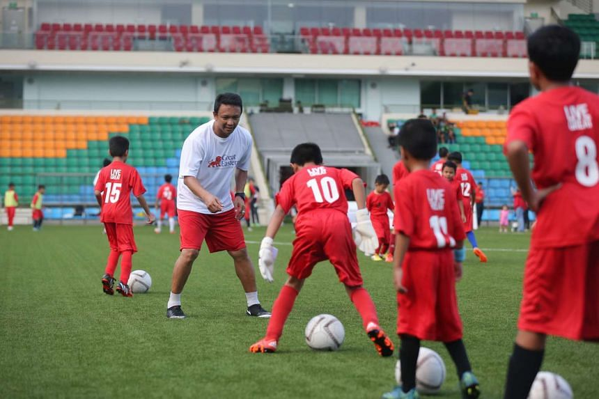 Fandi Ahmad and other ex-Lions coaching children from low-income families.