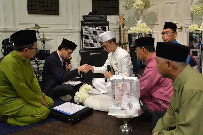 Sezairi Sezali (centre) had his wedding solemnised today (Jan 23) at the Timber Music Academy at Old Parliament Lane.