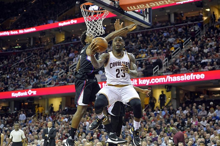 Cavaliers forward LeBron James going for a reverse lay-up against the Clippers in the third quarter of their game at Quicken Loans Arena, which Cleveland won 115-102.