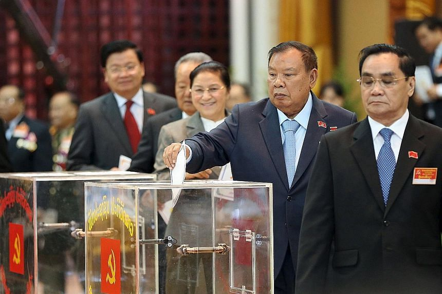 The Vice-President of Laos, Mr Bounnhang Vorachit, casting his ballot during the Communist Party congress in Vientiane. The 78-year-old was chosen yesterday to be the new leader of the highly secretive party.