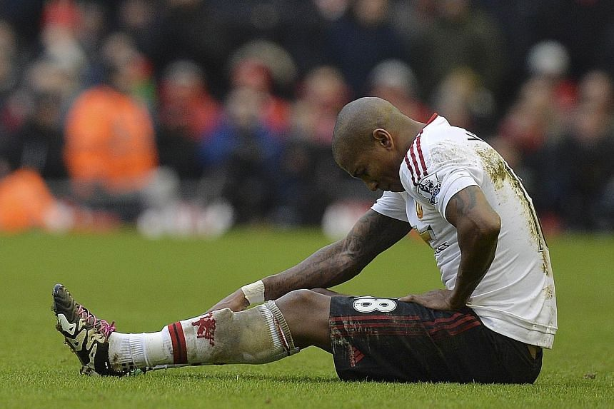 United midfielder Ashley Young sitting injured before being substituted during the 1-0 win over Liverpool at Anfield last Sunday.