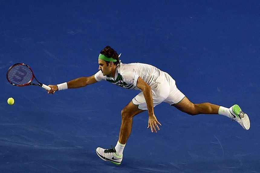 "Roger Federer stretching for a forehand return to ""Baby Fed"" Grigor Dimitrov. While largely untroubled, the Swiss lost the second set and committed an uncharacteristically high 55 unforced efforts in the match."