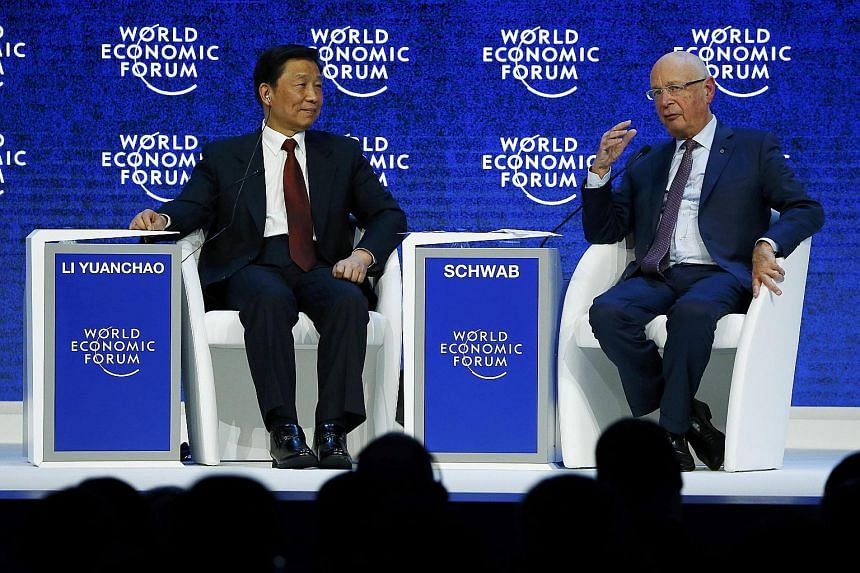 World Economic Forum executive chairman and founder Klaus Schwab speaking with Chinese Vice-President Li Yuanchao during the annual meeting of the forum in Davos, Switzerland, on Thursday.