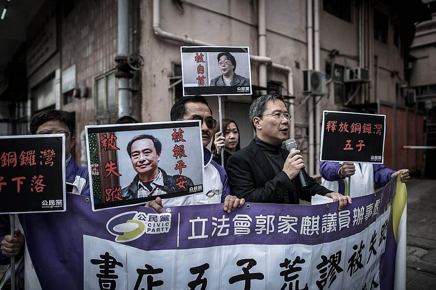 """Members of the Civic Party staging a protest over the missing booksellers outside China's liaison office in Hong Kong on Tuesday. Activists are calling on Hong Kong leader Leung Chun Ying to better defend what seems to be an increasingly troubled """"on"""