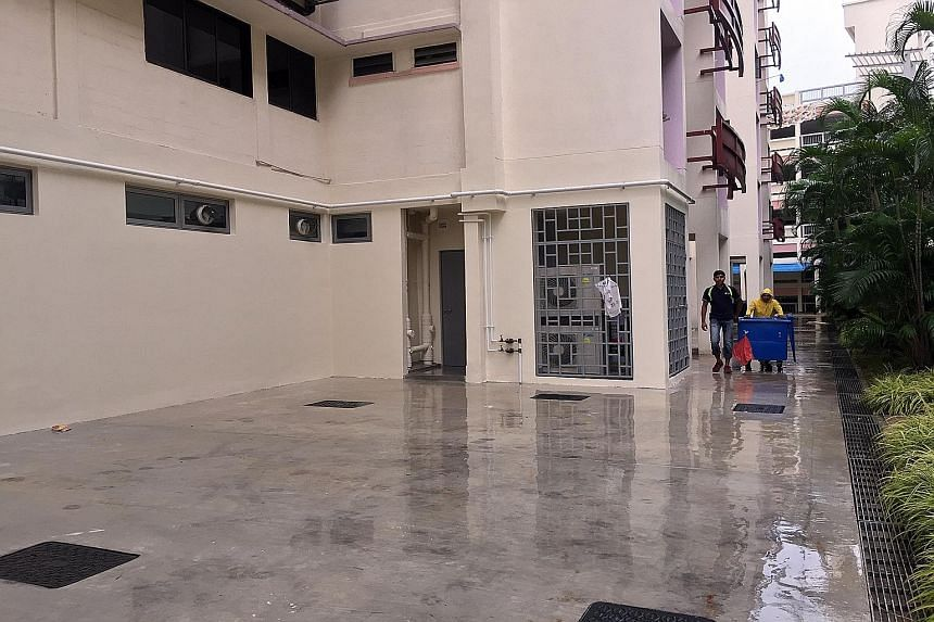 The space where the life pack was set up by SCDF officers (top left). The man could be seen on the ledge of the 12th-floor flat (above) before he fell to his death.