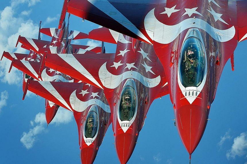 This photo of F-16C Fighting Falcons of the Republic of Singapore Air Force Black Knights by ST photojournalist Alphonsus Chern, taken last year, will be on display at the World Press Photo exhibition.