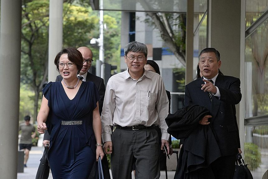 Workers' Party MPs Sylvia Lim and Png Eng Huat (centre) with lawyer Peter Low, who is representing Aljunied-Hougang Town Council, arriving at the Supreme Court yesterday. AHTC has said that it does not wish to make use of two of the Big Four accounti