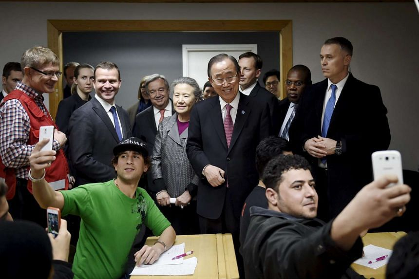 UN Secretary-General Ban Ki-moon (centre) visiting a reception centre for asylum seekers in Finland in December 2015.
