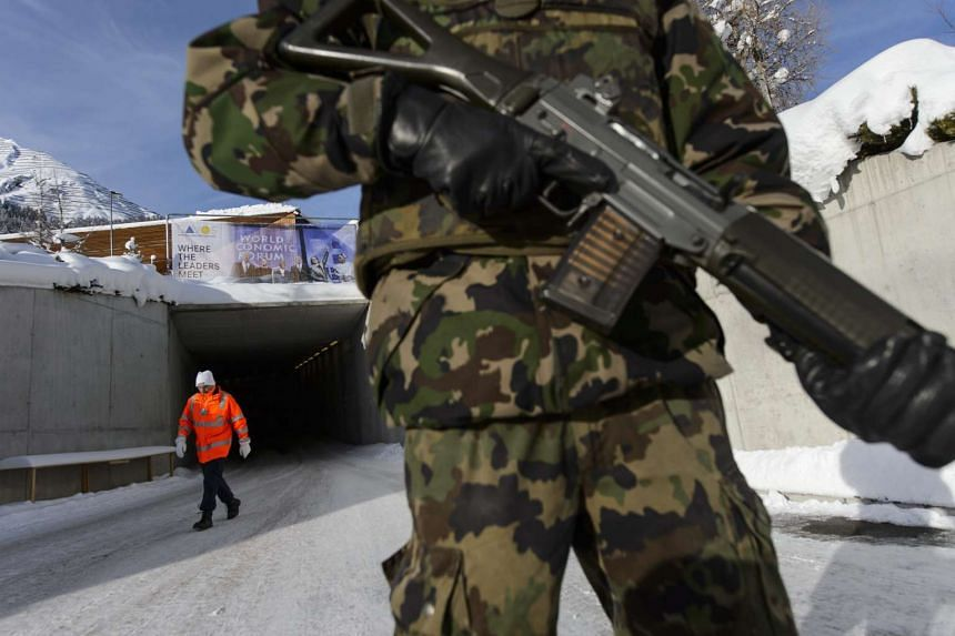 A Swiss Army soldier patrols outside the Congress Centre before the start of the WEF.