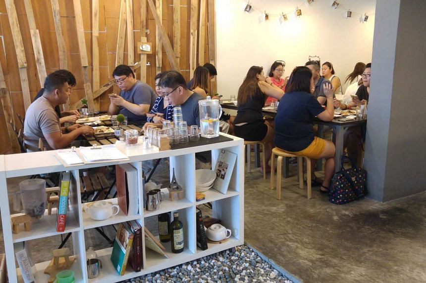 Customers ate breakfast while waiting for their croissants at Flavour Flings on Jan 23, 2016.