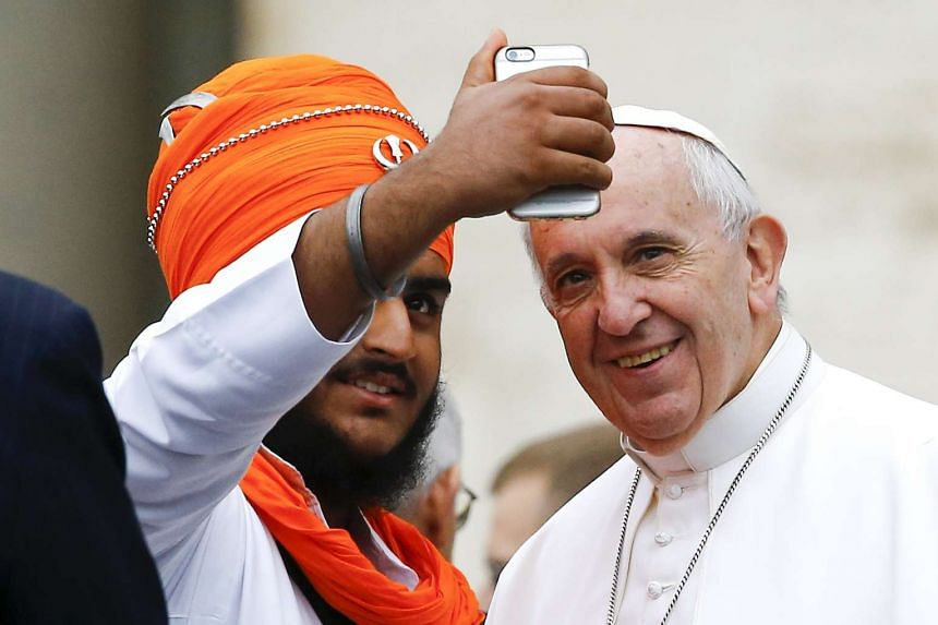 Pope Francis poses for a selfie during his weekly audience in Saint Peter's Square in October 2015.
