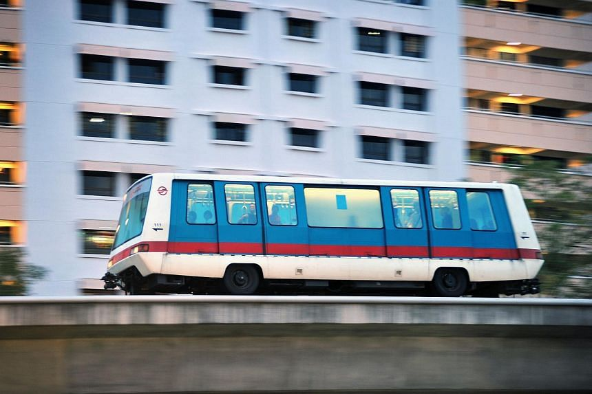 An LRT train travelling along the Bukit Panjang LRT line.