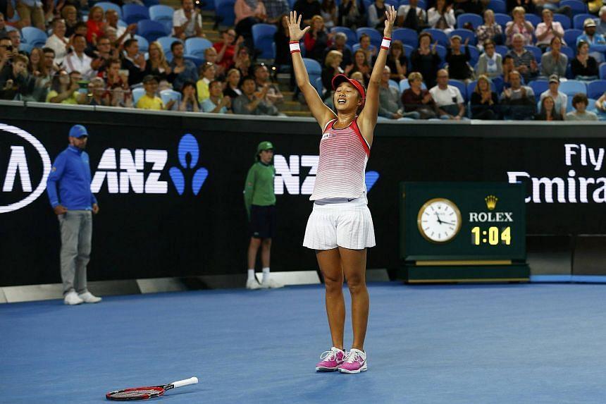 Zhang Shuai celebrates after winning her third round match against Varvara Lepchenko at the Australian Open.