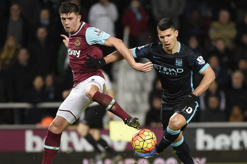 Manchester City's Sergio Aguero (right) vies for the ball against West Ham's Aaron Cresswell on Jan 23, 2016.