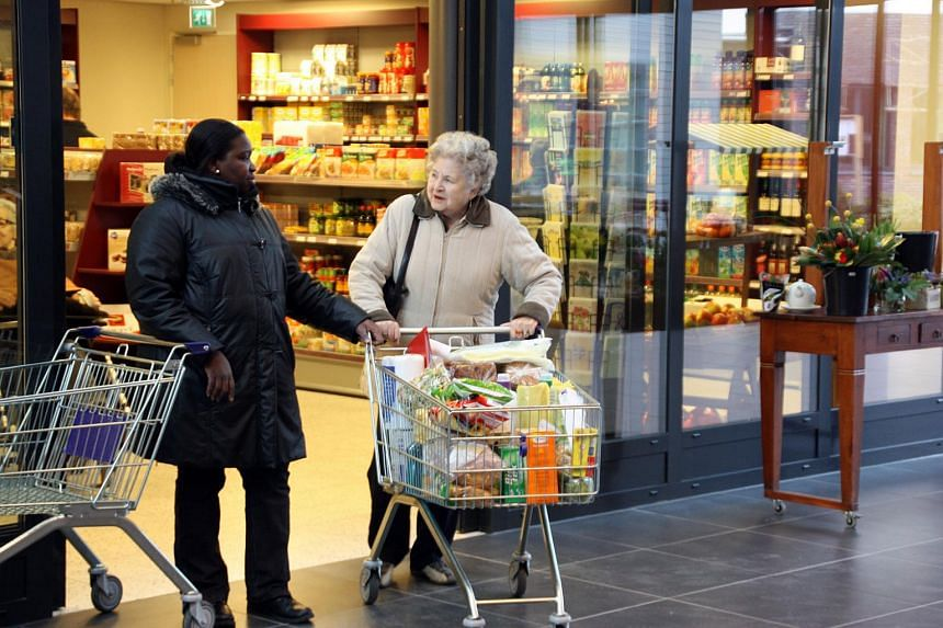 A supermarket in a dementia village, De Hogeweyk, in Amsterdam, where patients are encouraged to shop for their daily needs, using a monthly budget allocated to each household.