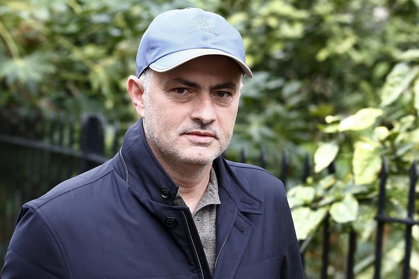 Former Chelsea manager Jose Mourinho takes a walk near his home in London.