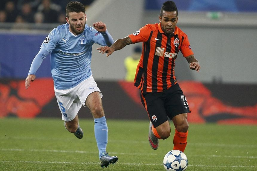Shakhtar Donetsk's Alex Teixeira (right) in action with Malmo's Erdal Rakip in Lviv, Ukraine, on Nov 3, 2015.