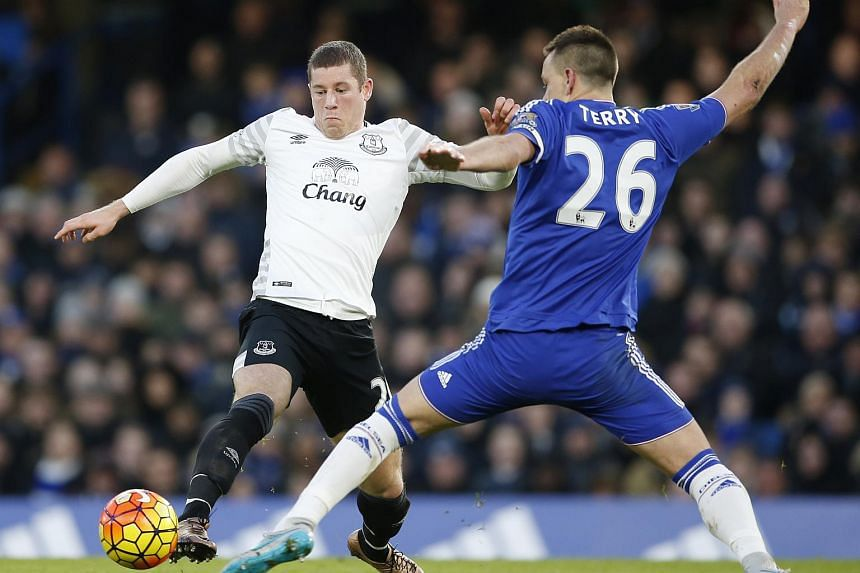 Everton's Ross Barkley (left) in action with Chelsea's John Terry.