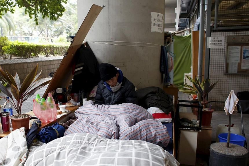 A street sleeper napping under a bridge near a residential area in Hong Kong, where temperatures fell to as low as 3.3 deg C on Sunday (Jan 24) morning.