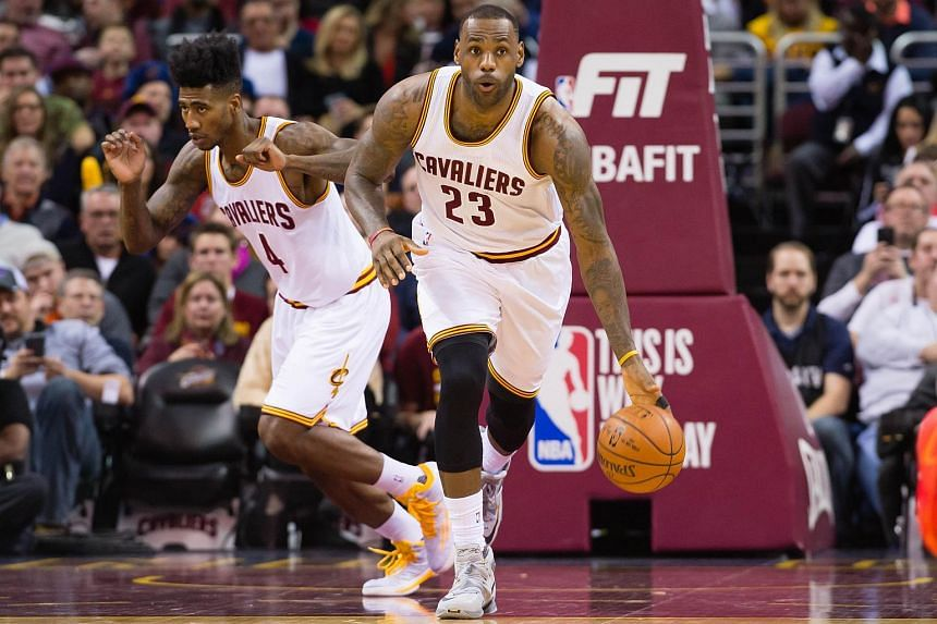 LeBron James #23 takes the ball down court followed by Iman Shumpert #4 of the Cleveland Cavaliers on Jan 23, 2016.