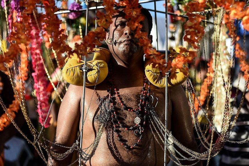 A Malaysian Hindu devotee walks towards the Batu caves temple during the Thaipusam festival celebrations in Kuala Lumpur, on Jan 24, 2016.