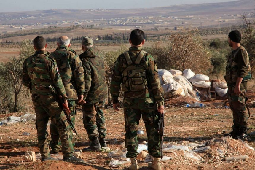 Syrian government forces monitoring an area near the village of Khan Tuman, south of Aleppo, on Dec 22, 2015.