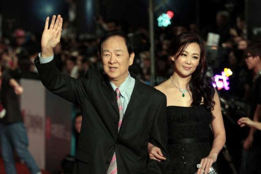 Wang Yu (left), seen with his daughter, has been hospitalised after suffering a stroke.