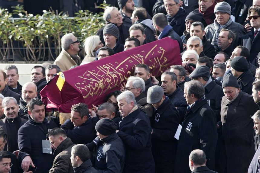 People carry the coffin of Mustafa Koc at his funeral ceremony at a mosque in Istanbul on Jan 24, 2016.