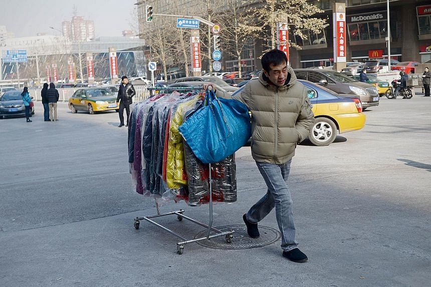 Unigestion's Mr Bruno Taillardat says his top picks are healthcare stocks in India and telecoms shares in Indonesia. A man pushing a rack of clothes along a street in Beijing last Tuesday. Mr Bruno Taillardat thinks the Chinese A-shares - those liste