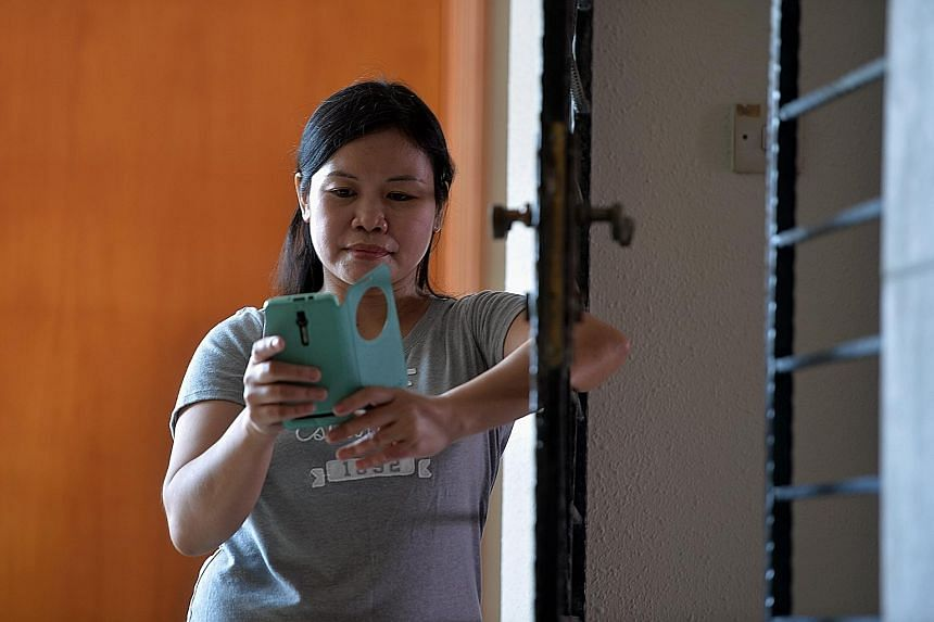 Filipino maid Nilda Sesaldo bought SMS codes through online portal BeamAndGo, which her teenage daughter used to redeem vouchers for groceries at the supermarket and a new phone at a local shop.