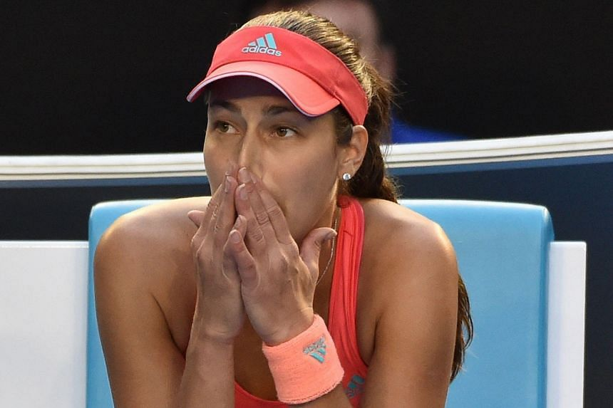 A worried Ana Ivanovic looking towards her box as medical staff tended to her collapsed coach Nigel Sears.