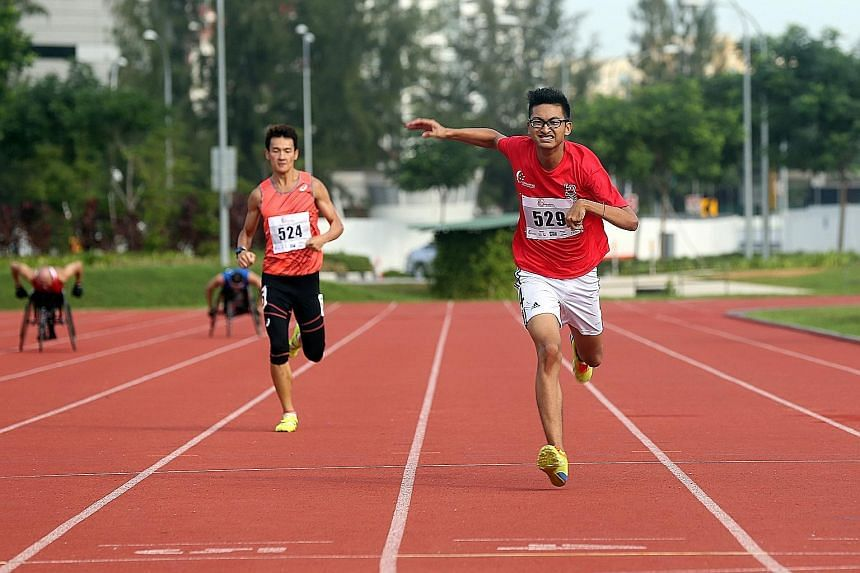 Singapore para-athletes Lionel Toh (right) and Zac Leow competing in the 200m race of the Singapore Athletics Track and Field Series One yesterday. A total of 11 para-athletes signed up for the event, held at the Kallang Practice Track. Some 700 are