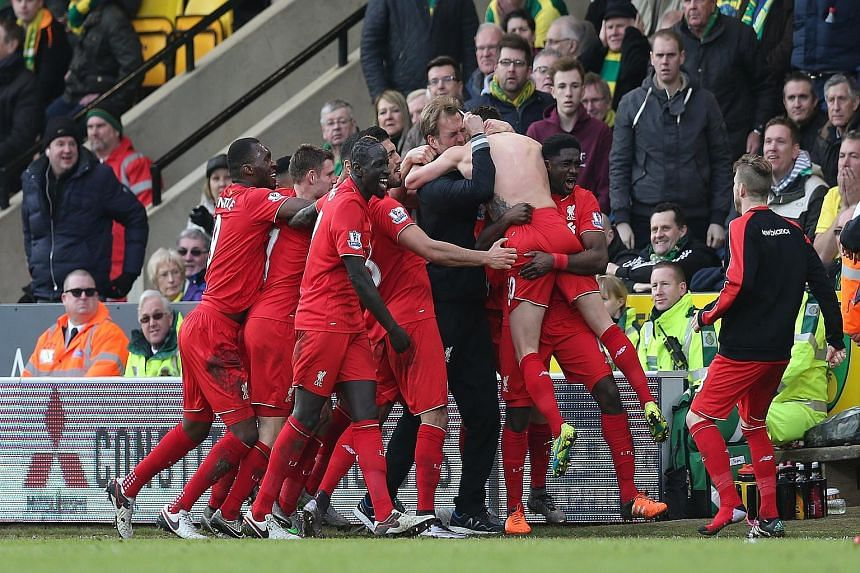 Clockwise from top: Adam Lallana celebrating by jumping onto Juergen Klopp after scoring Liverpool's fifth goal. The backheel opener from Norwich's Dieumerci Mbokani. Roberto Firmino on the double with the third goal for Liverpool.