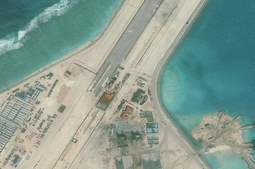 Part of the Subi Reef runway on an isle built by Beijing in the South China Sea. US Defence Secretary Ashton Carter has called on all parties in the region to stop actions which militarise the situation in the disputed South China Sea and pointed out